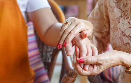 Mothers Day is a celebration honoring the mother of the family , Close up hands