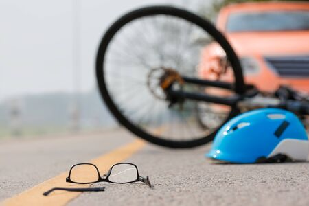Accident car crash with bicycle on road because drunk driving Banco de Imagens