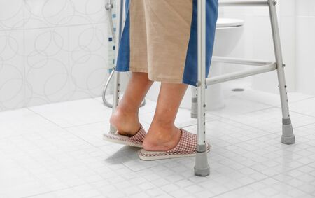Elderly swollen feet or edema leg walk into bathroom