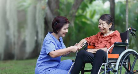 elderly woman happiness talking with caregiver