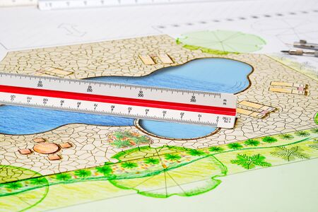 Landscape architect design backyard pool plan with metric scale ruler