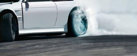 Race drift car burning tires on speed track Banco de Imagens