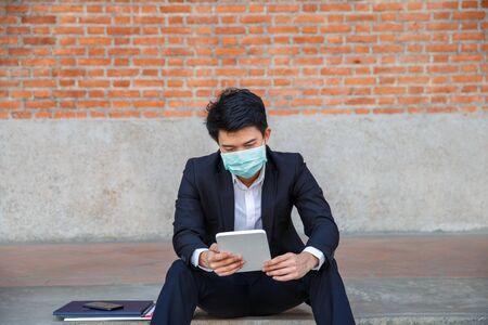 Business man in distress of job losses due to COVID-19 virus pandemic Foto de archivo