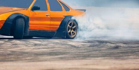 Race drift car burning tires on speed track Reklamní fotografie