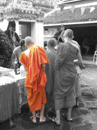 monk sees doing sweets, wat po in Bangkok