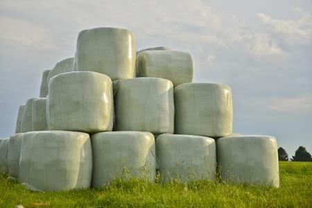 Straw bales in plastic envelope photo