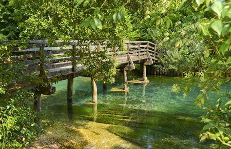 idylle: Romantic river landscape with bridge Stock Photo