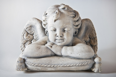 Angel on upholstery with light background   photo