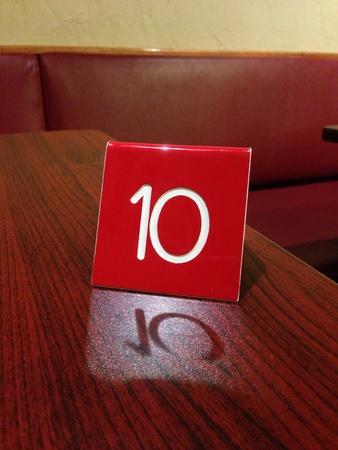 The waiting is the hardest part number on table at restaurant...