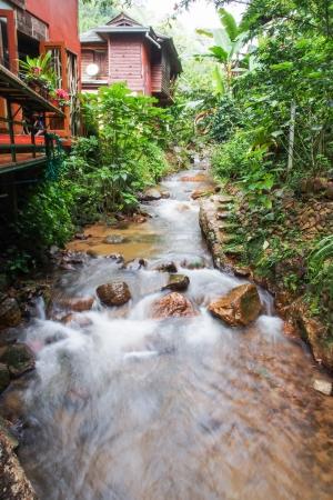 small stream near house Chiang Mai Thailand photo