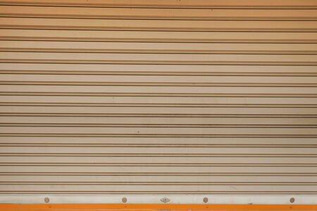 �Old Light yellow Shutter door photo