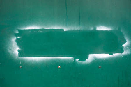 space word on green iron wall texture photo