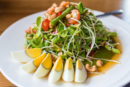 organic sunflower sprout  in spicy salad with boiled eggs