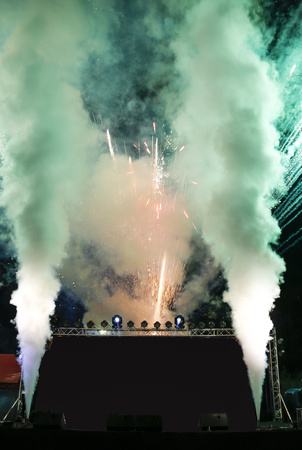 stage with green tone firework with smoke opening event