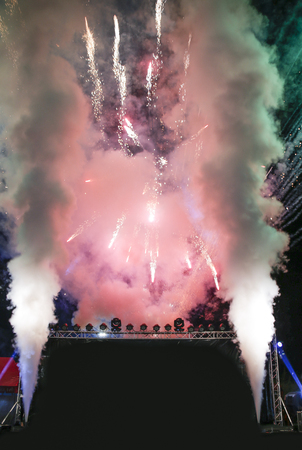 stage with red tone firework with smoke opening event