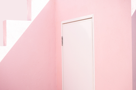 white door on pink wall with sunlight and shadown Banco de Imagens - 90243023
