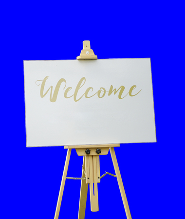 Standee with white board and welcome text on blue chroma keying background Banco de Imagens