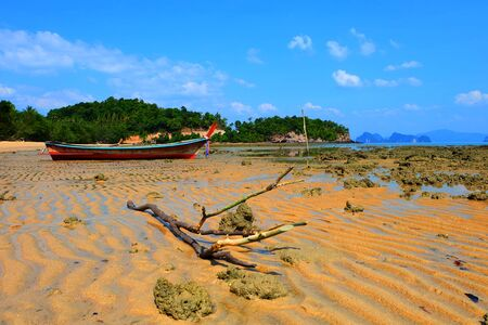 fisher: Fisher boat beside beach.
