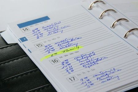 scheduled: An organizer with many dates and a scheduled date for the family.