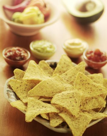 Nachos and four different dips photo