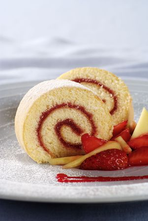 swiss roll: Two slices of strawberry jam Swiss roll  Stock Photo