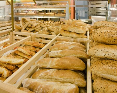 Loaves of bread on shelves in a store photo