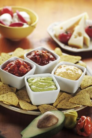 Tortilla Chips with Various Dips photo