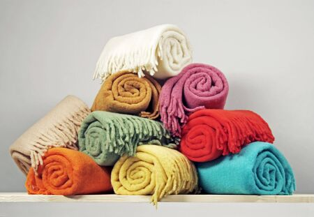 Heap of rolled up blankets  Stock Photo
