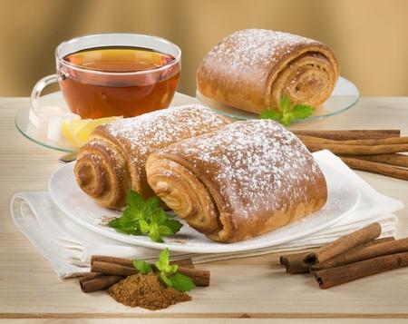 Tea and sweet cinnamon cakes photo