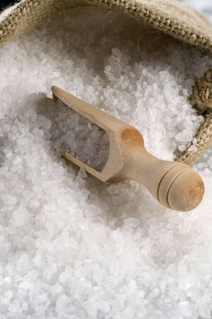 Sea salt in a burlap sack and a wooden scoop Stock Photo - 4614491