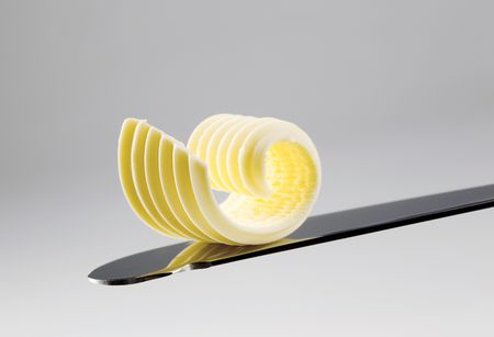 Butter curl on a knife  Stock Photo