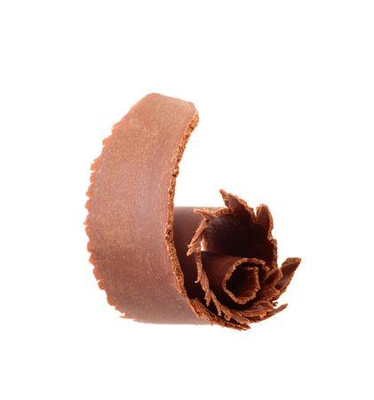 Chocolate shaving isolated on white photo