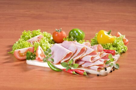 thinly: Thinly sliced gyros ham and fresh vegetables