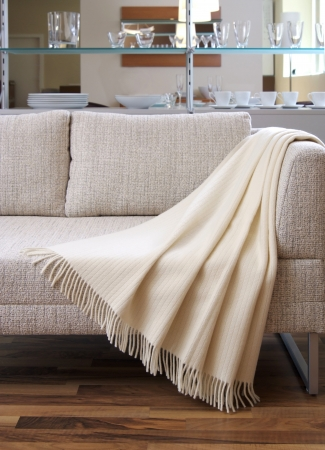 settee: Cream throw draped over a settee