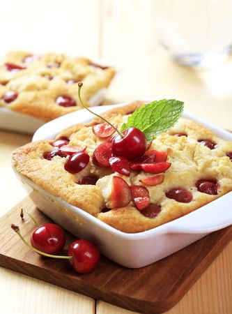 Cherry sponge cakes in ceramic dishes photo