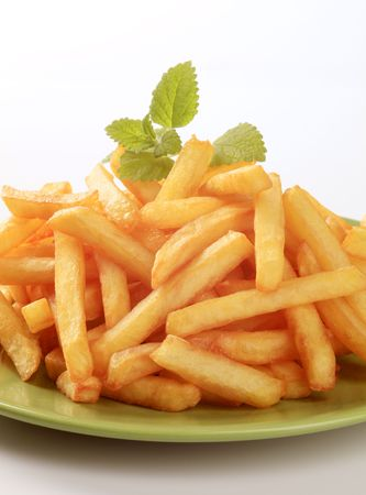 french fries: Heap of French fries  on a green plate Stock Photo