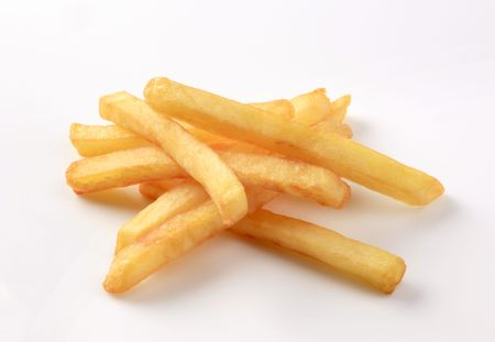 frites: Heap of French fries on white background Stock Photo