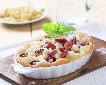 Fresly baked cherry sponge cake in an oval casserole dish Stock Photo - 5268911