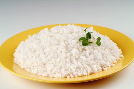 Boiled white rice on a yellow plate