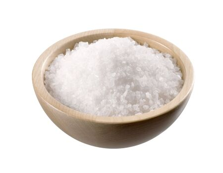 salt crystal: Sea salt in a  wooden bowl isolated on white Stock Photo