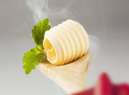 Butter curl on a wooden spoon in steam Stock Photo - 5268950