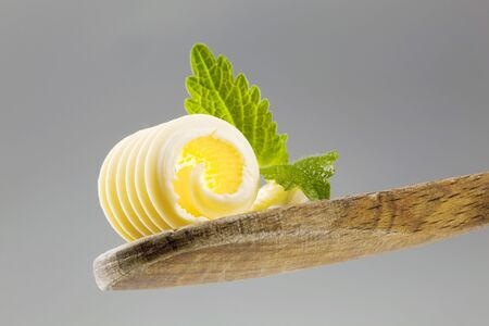 Closeup of a butter curl on a wooden spoon Stock Photo - 5268932