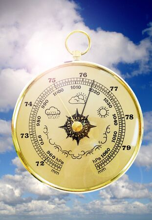 weather gauge: Barometer with cloudy sky in the background  Stock Photo