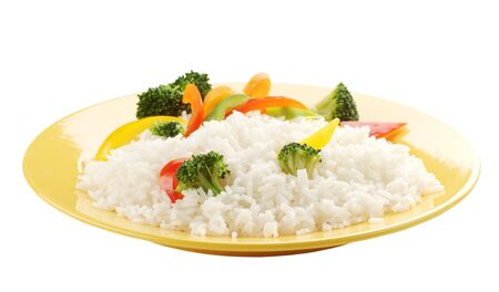 plateful: Boiled rice with vegetables on a yellow plate Stock Photo
