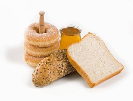 a jar stand: Fresh bread, donuts and a jar ofhoney  Stock Photo