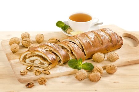 Walnut roll and a cup of tea photo