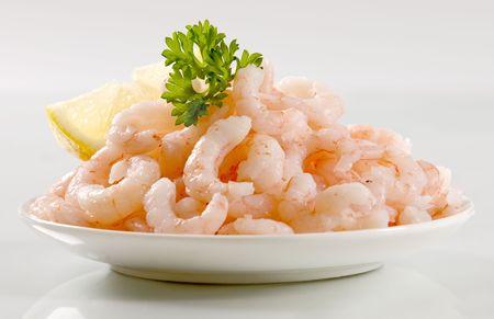 plateful: Plateful of peeled shrimps  Stock Photo