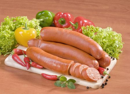 Still life of sausages and fresh vegetables  photo