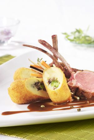 Lamb chops served filled with potato croquettes  photo