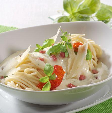 Spaghetti alla carbonara in a stylish plate photo